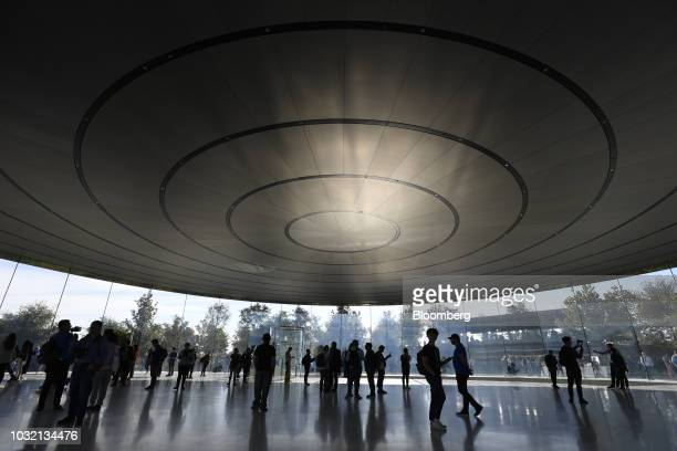 Attendees arrive for an Apple Inc event at the Steve Jobs Theater in Cupertino California US on Wednesday Sept 12 2018 Apple will kick off a blitz of...