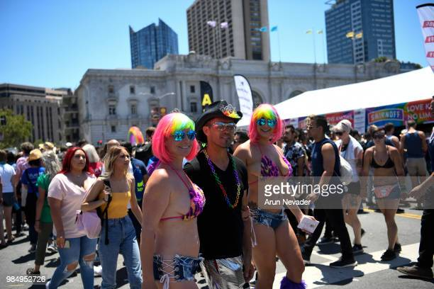 Attendees arrive for the celebration during the 2018 San Francisco Pride Parade on June 24 2018 in San Francisco California
