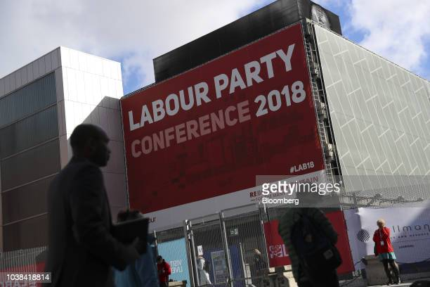 Delegates take a break outside the venue for the annual Labour Conference in Liverpool UK on Monday Sept 24 2018 Party leaderJeremy Corbyn said he...