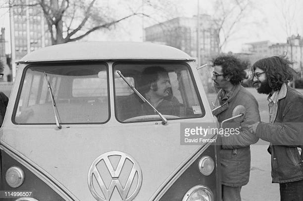 Attendees at a Black Panther rally in support of Erica Huggins and Bobby Seale gather around a Volkswagen van New Haven CT May 12 1970