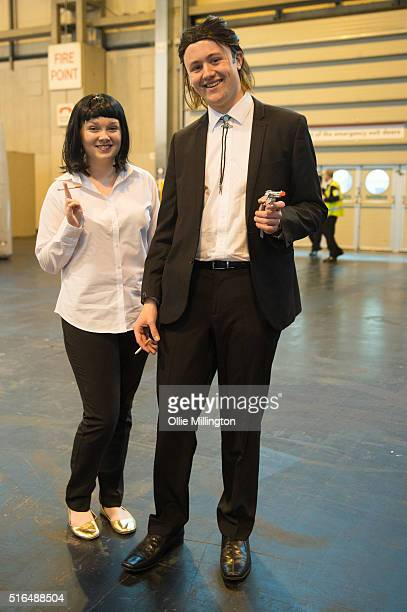 Attendees at Comic Con 2016 in cosplay as Mia Wallace and Vincent Vega from Pulp Fiction on March 19 2016 in Birmingham United Kingdom