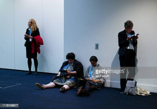 Attendees at conference wait in a corridor on the second day of the Conservative Party Conference at Manchester Central on September 30 2019 in...
