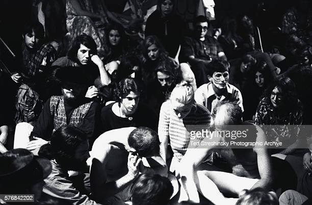 Attendees at the Merry Pranksters' Acid Test Graduation join Ken Kesey and Neal Cassady in meditation Most of them are high on LSD25