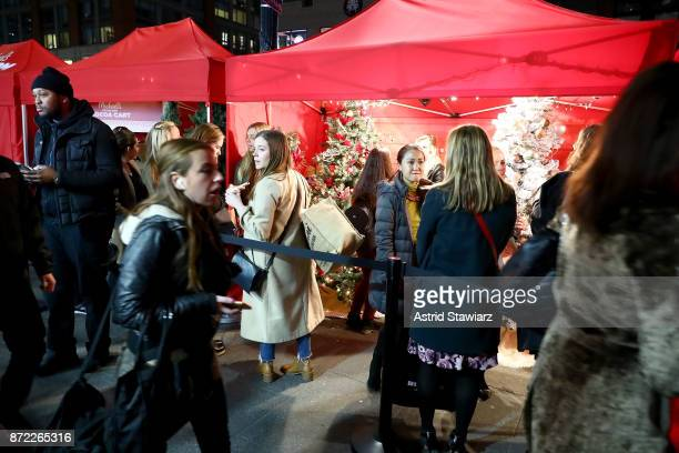 Attendees at the Michaels Faux Tree Farm popup in NYC choose their perfect fake firs explore trimmings and holiday decor and check out the years top...