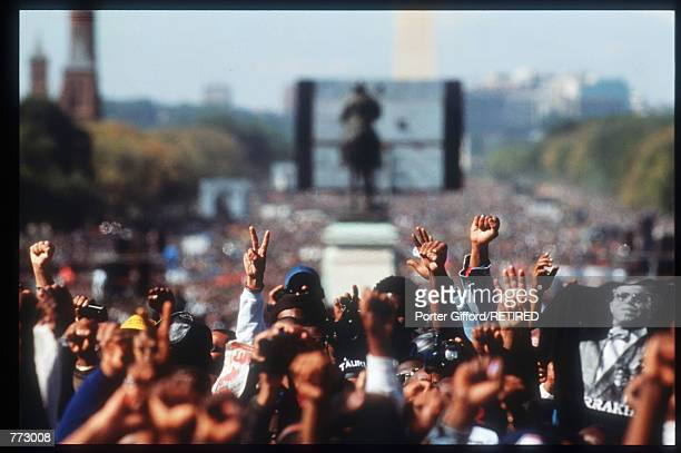 Attendees at the Million Man March raise their hands in fists and peace/victory signs October 16, 1995 in Washington, DC. The purpose of the march...