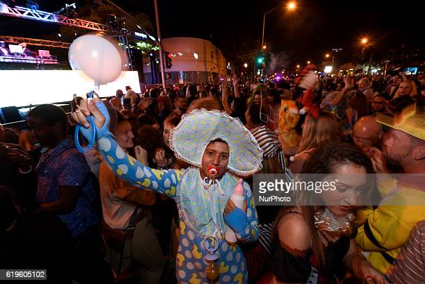 Attendees at the West Hollywood Halloween Carnaval known as the world's largest Halloween street party West Hollywood California October 31 2016...