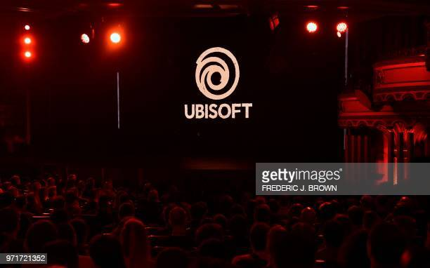 Attendees await the start of the Ubisoft E3 2018 media briefing at the Orpheum Theatre in Los Angeles California on June 11 ahead of the 24th...