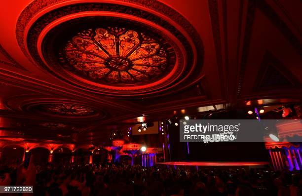 Attendees await the start of the Ubisoft E3 2018 media briefing inside the Orpheum Theatre in Los Angeles California on June 11 ahead of the 24th...