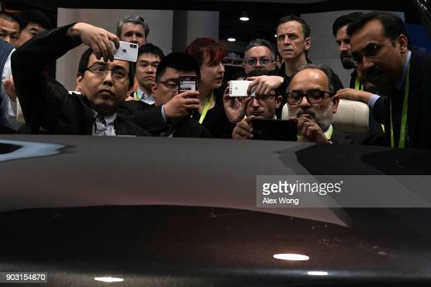 Attendees browse exhibition on autonomous driving at the Hyundai Mobis booth during CES 2018 at the Las Vegas Convention Center on January 10 2018 in...