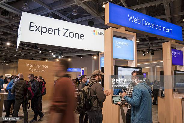 Attendees browse features on display at the Microsoft Developers Build Conference in San Francisco California US on Thursday March 31 2016 Microsoft...