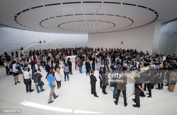 Attendees browse new products on display during an Apple Inc event at the Steve Jobs Theater in Cupertino California US on Wednesday Sept 12 2018...
