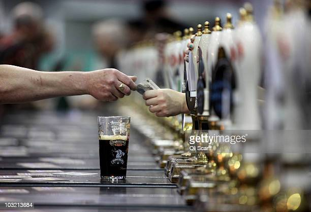 Attendees buy beer at the 'Great British Beer Festival 2010' in Earls Court exhibition centre on August 3 2010 in London England The 5day event is...