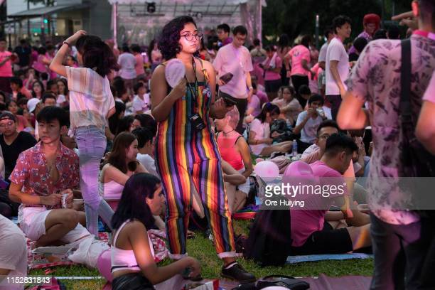 Attendees can be seen during the Pink Dot event held at the Speaker's Corner in Hong Lim Park on June 29 2019 in Singapore