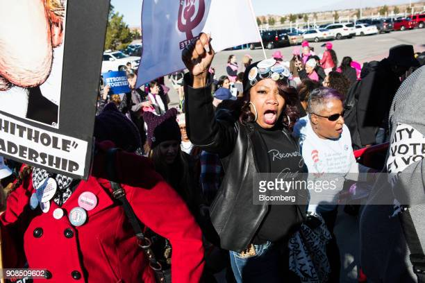 Attendees carry signs and chant before entering the Sam Boyd Stadium during the Women's March OneYear Anniversary Power To The Polls event in Las...