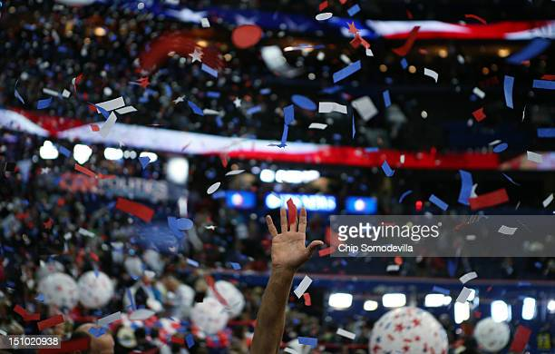 Attendees celebrate as confetti and balloon drop after Republican presidential candidate, former Massachusetts Gov. Mitt Romney accepted the...