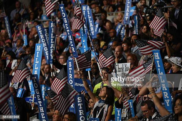 Attendees celebrate as Democratic Presidential Nominee Hillary Clinton addresses the Democratic National Convention in Philadelphia on Thursday July...