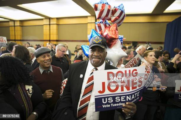Attendees celebrate during an election night party for Senatorelect Doug Jones a Democrat from Alabama in Birmingham Alabama US on Tuesday Dec 12...