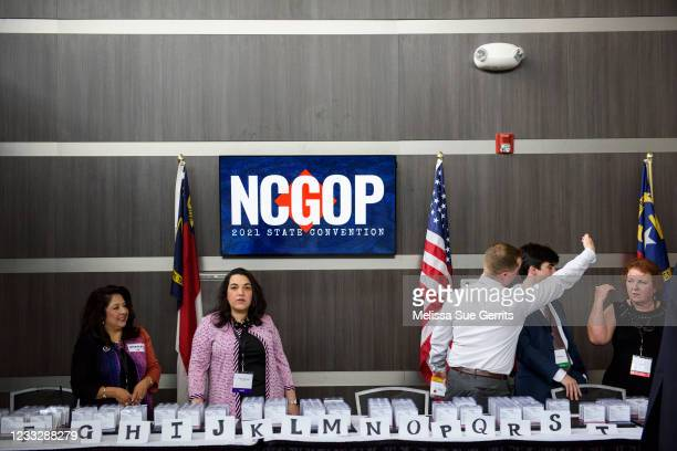 Attendees check in at the North Carolina GOP convention on June 5, 2021 in Greenville, North Carolina. Former U.S. President Donald Trump is...