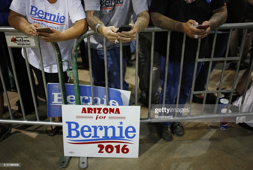 Attendees check their mobile devices before a campaign event for Senator Bernie Sanders, an independent from Vermont and 2016 Democratic presidential candidate, not pictured, in Phoenix, Arizona, U.S., on Tuesday, March 15, 2016. In Democratic forums,Sanders and Hillary Clinton argue that deportations are ripping apart hard-working undocumented people who are merely trying to make a good life for their families, and that the president must show them mercy, even if it means stretching the limits of the law. Photographer: Luke Sharrett/Bloomberg via Getty Images