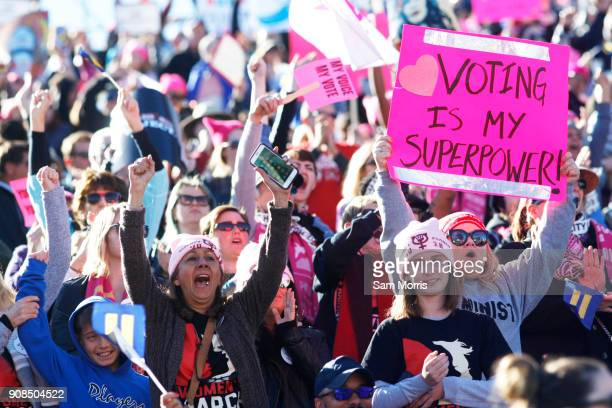 Attendees cheer a speaker during the Women's March Power to the Polls voter registration tour launch at Sam Boyd Stadium on January 21 in Las Vegas...
