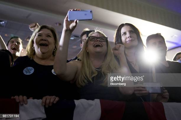 Attendees cheer as Conor Lamb Democratic candidate for the US House of Representatives not pictured speaks during an election night rally in...