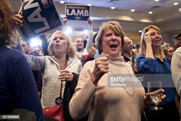Attendees cheer as election numbers are reported during an election night rally for Conor Lamb Democratic candidate for the US House of...