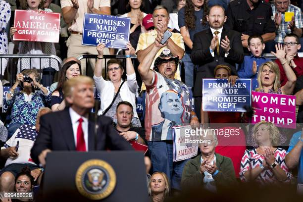 Attendees cheer as President Donald Trump speaks during a rally in Cedar Rapids Iowa US on Wednesday June 21 2017 Russia canceled talks with a top US...