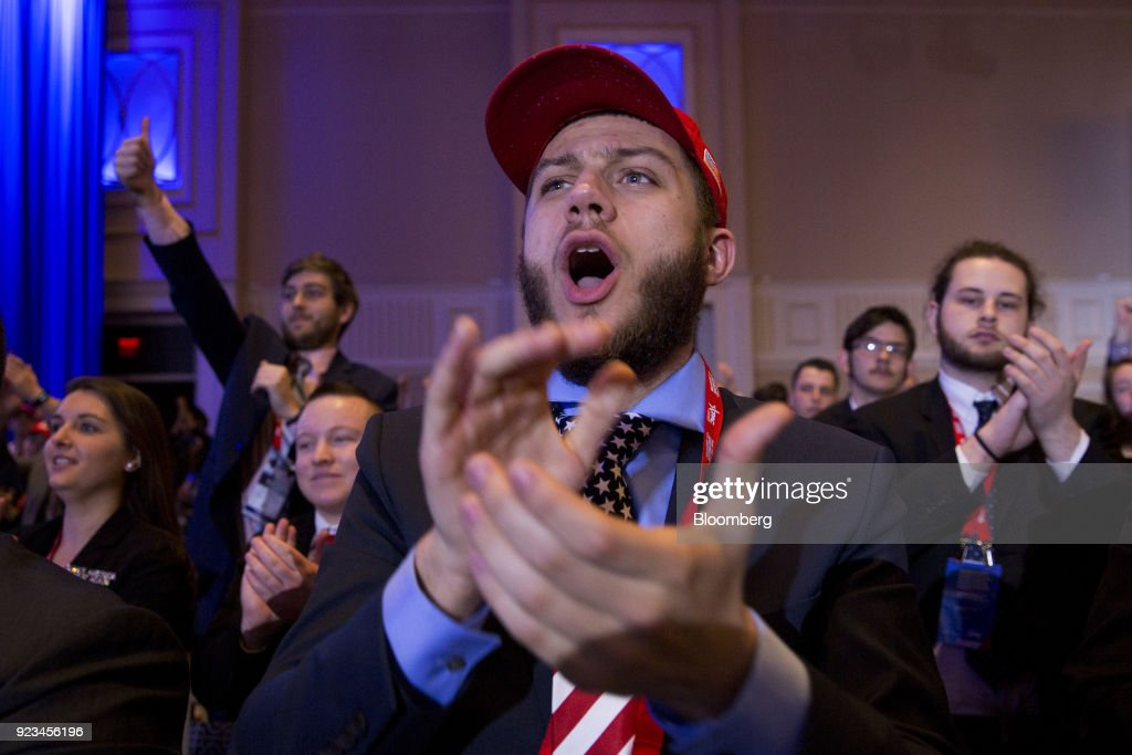 Attendees cheer as U.S. President Donald Trump, not pictured, speaks at the Conservative Political Action Conference (CPAC) in National Harbor, Maryland, U.S., on Friday, Feb. 23, 2018. The list of speakers at CPAC includes two European nativists who are addressing the gathering between panels and events on the dangers of immigration, Sharia law and lawless government agencies. Photographer: Andrew Harrer/Bloomberg via Getty Images
