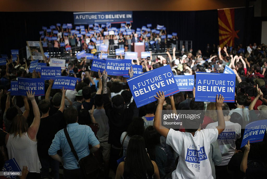 Attendees cheer during a campaign event for Senator Bernie Sanders, an independent from Vermont and 2016 Democratic presidential candidate, not pictured, in Phoenix, Arizona, U.S., on Tuesday, March 15, 2016. In Democratic forums, Sanders and Hillary Clinton argue that deportations are ripping apart hard-working undocumented people who are merely trying to make a good life for their families, and that the president must show them mercy, even if it means stretching the limits of the law. Photographer: Luke Sharrett/Bloomberg via Getty Images
