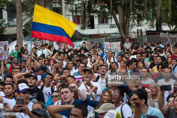 Attendees cheer during a campaign rally for Gustavo Petro presidential candidate for the Progressivists Movement Party not pictured in Medellin...