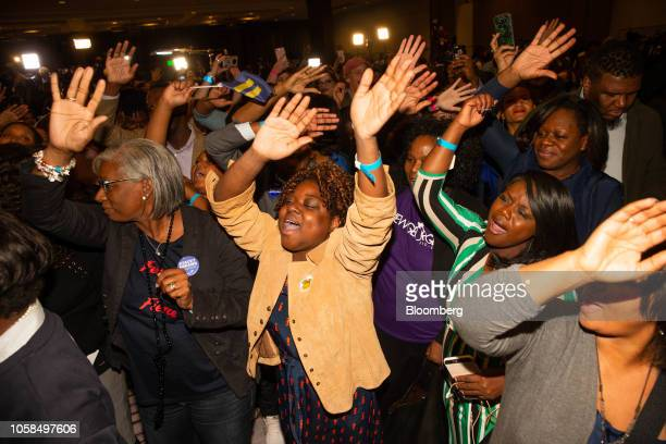 Attendees cheer during an election night watch party for Stacey Abrams Democratic nominee for governor of Georgia not pictured in Atlanta Georgia US...