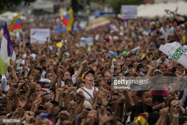 Attendees cheer during the closing campaign rally for Evangelical pastor Javier Bertucci presidential candidate for the Esperanza Por El Cambio Party...