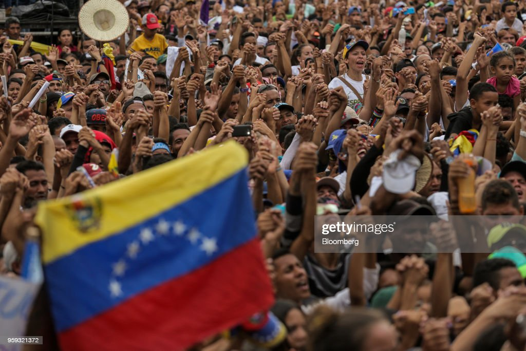 Attendees cheer during the closing campaign rally for Evangelical pastor Javier Bertucci, presidential candidate for the Esperanza Por El Cambio (EEC) Party, in Valencia, Carabobo state, on Wednesday, May 16, 2018. Venezuelans head to the polls on May 20, as foreign leaders call for a suspension and the country's main opposition alliance shun the elections. Photographer: Manaure Quintero/Bloomberg via Getty Images