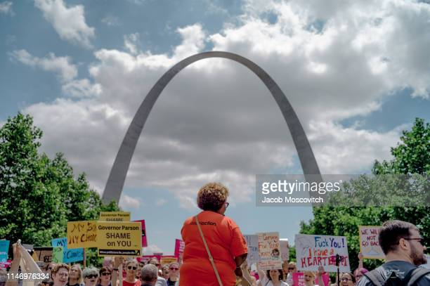 Attendees clap shout and react to a Planned Parenthood speaker during a rally to protest the closure of the last abortion clinic in Missouri on May...