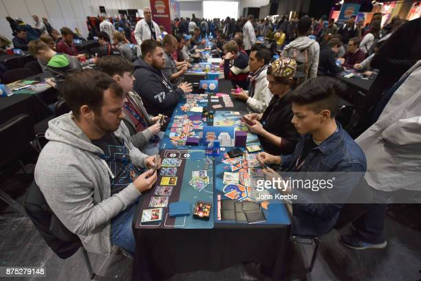 Attendees compete at the Pokemon European International Championships at ExCel on November 17 2017 in London England Thousands of competitors from...