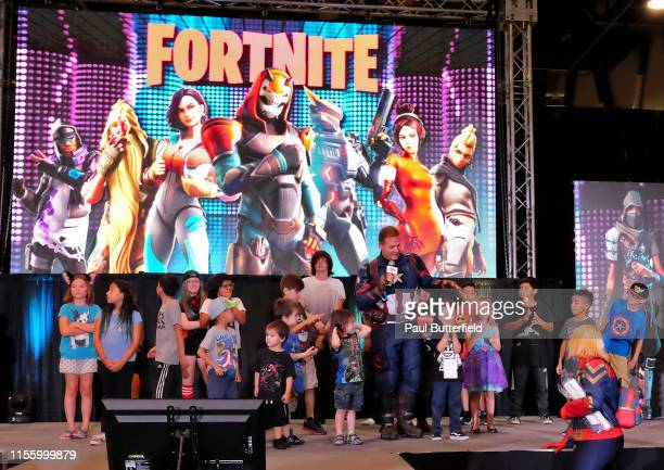 Attendees compete in a 'Fortnite' dance competition during the Seventh Annual Amazing Las Vegas Comic Con at the Las Vegas Convention Center on June...