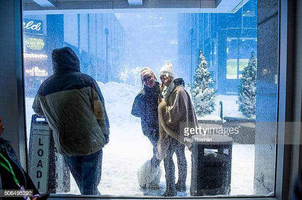 Attendees cope with the snow during BroadwayCon 2016 at the New York Hilton Midtown on January 23 2016 in New York City