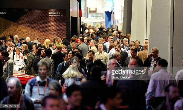 Attendees crowd the hallways between vendor's booths at the 2013 International CES at the Las Vegas Convention Center on January 8 2013 in Las Vegas...