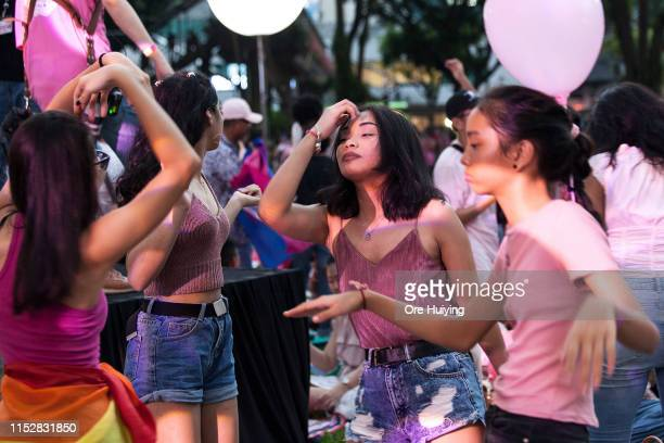 Attendees dance during the Pink Dot event held at the Speaker's Corner in Hong Lim Park on June 29 2019 in Singapore