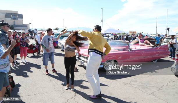 Attendees dance during the Viva Las Vegas Rockabilly Weekend's car show at the Orleans Arena on April 20 2019 in Las Vegas Nevada