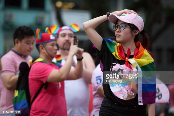Attendees decked in rainbow accessories can be seen during the Pink Dot event held at the Speaker's Corner in Hong Lim Park on June 29 2019 in...