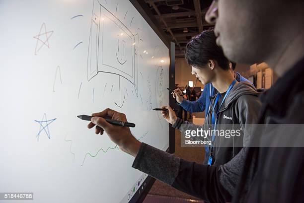 Attendees demonstrate the Microsoft Corp Surface Hub at the Microsoft Developers Build Conference in San Francisco California US on Thursday March 31...