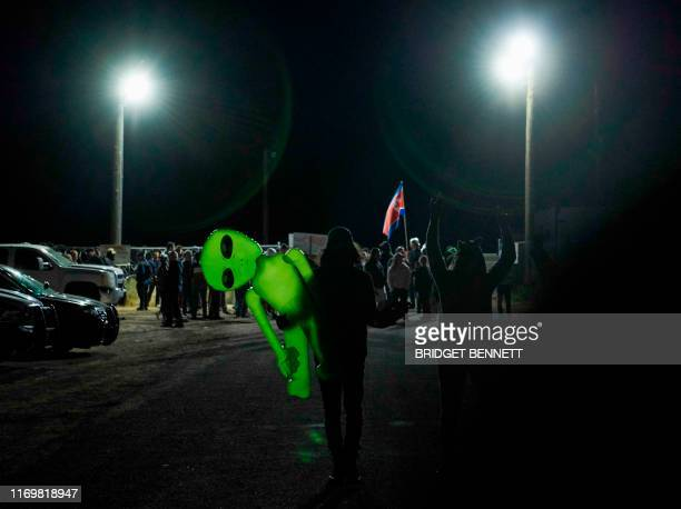 Attendees depart after gathering to storm Area 51 at an entrance to the military facility near Rachel Nevada on September 20 2019