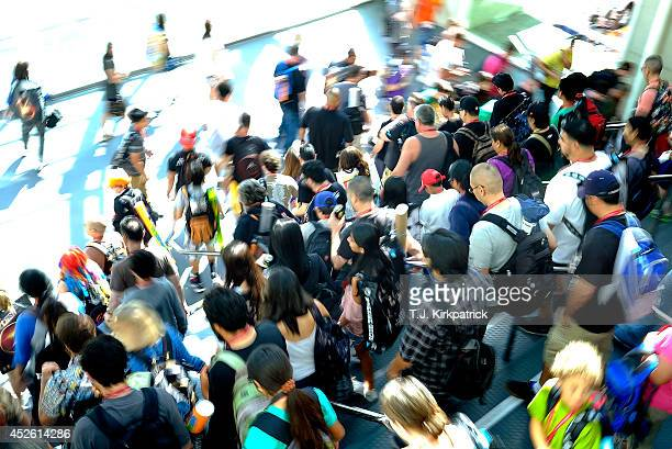 Attendees descend stairs as the entrance opens up during the 45th annual San Diego Comic-Con on July 24, 2014 in San Diego, California. An estimated...