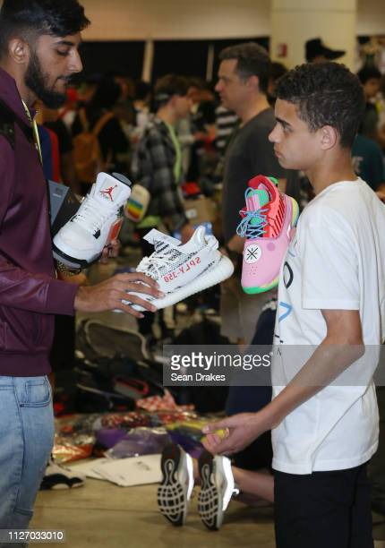 Attendees discuss a sneaker sale during SneakerCon 2019 at Fort Lauderdale Convention Center on February 2 2019 in Fort Lauderdale Florida