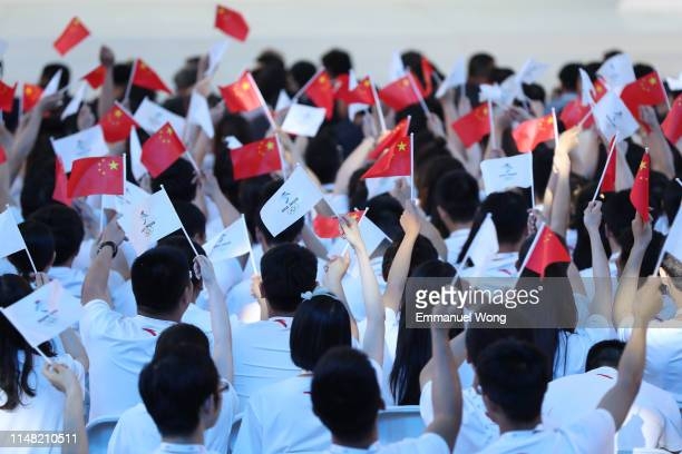 Attendees display Chinese and Olympic flags during the 1000-day Countdown to the Opening Ceremony of the Beijing 2022 Olympic Winter Games on May 10,...