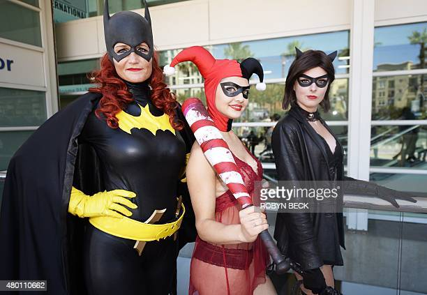Attendees dressed as Batgirl Harley Quinn and Catwoman pose on the first day of Comic Con International in San Diego California July 9 2015 AFP PHOTO...
