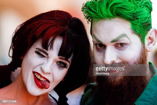 Attendees dressed as DC Comics' Harley Quinn left and Joker stand for a photograph during the ComicCon International convention in San Diego...