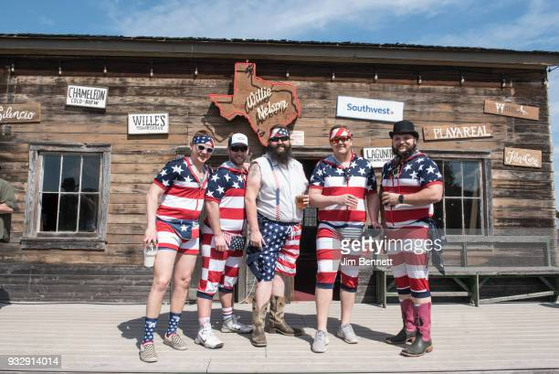 Attendees dressed in American flag clothes pose for a photo at the Luck Reunion held on Willie Nelson's ranch on March 15 2018 in Spicewood Texas
