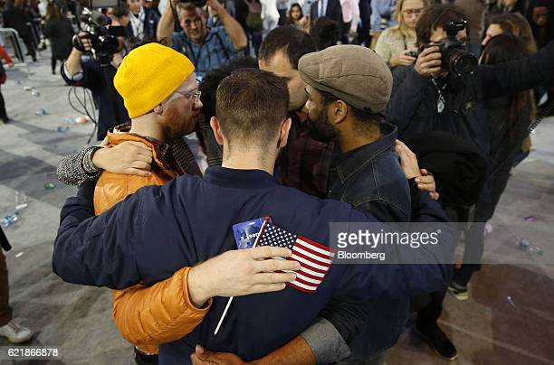 Attendees embrace after an election night party for 2016 Democratic Presidential Candidate Hillary Clinton at the Javits Center in New York US on...